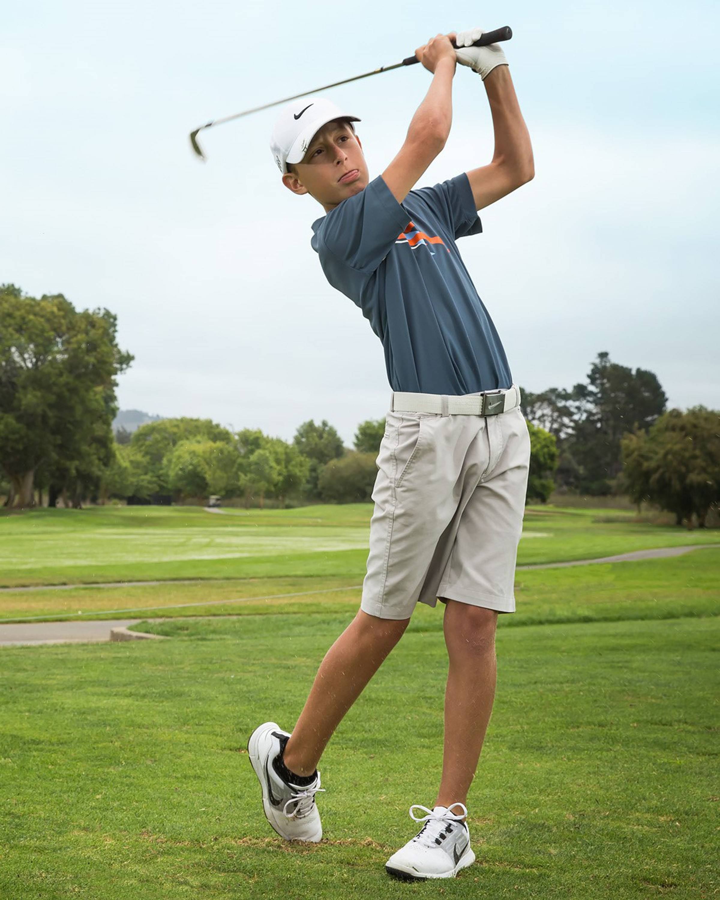 A golfer practices his swing at the Nike Junior Golf Camp in Monterey, California.
