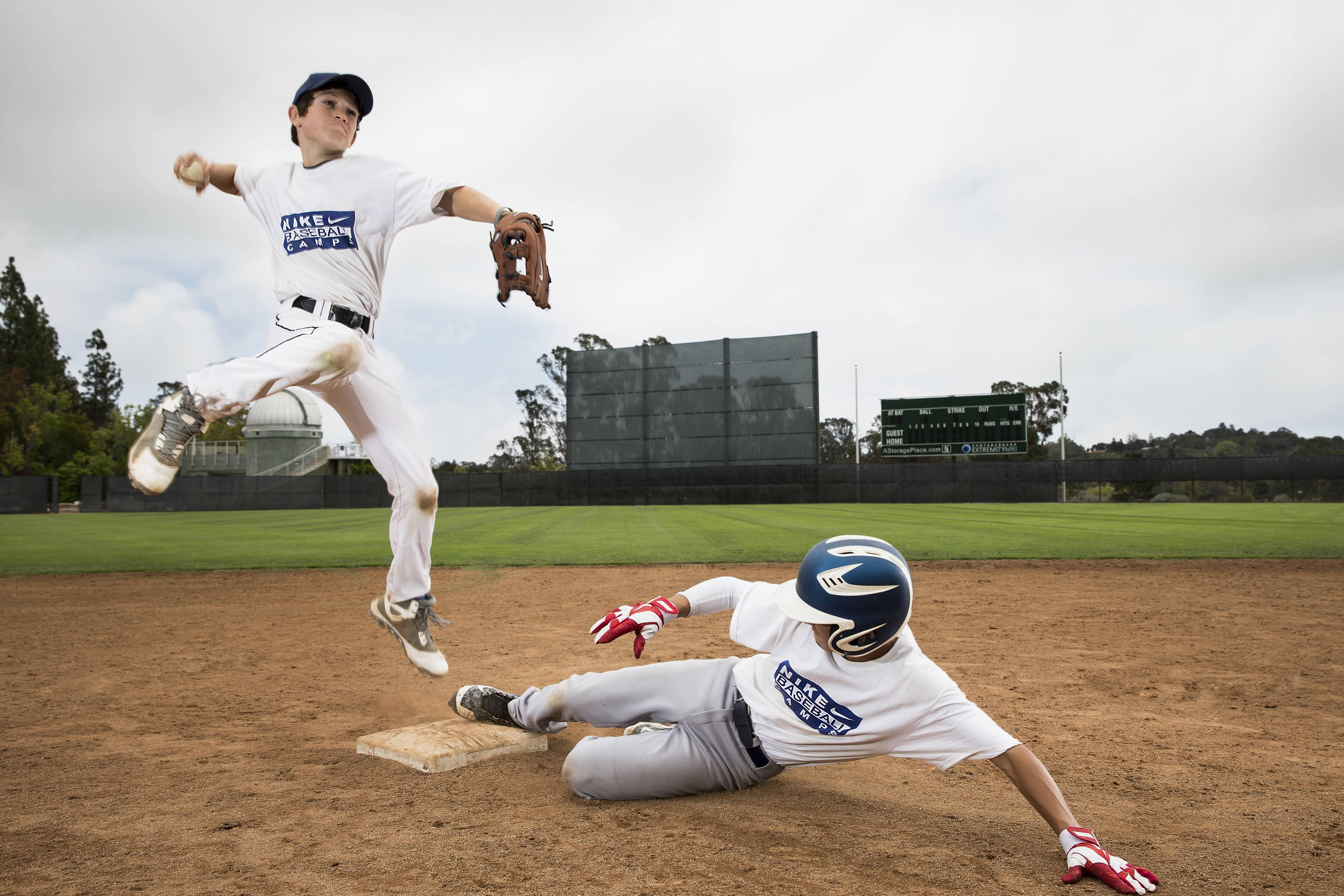 Kids turn a double play at the Nike Baseball Camp summer program in Santa Barbara, California.