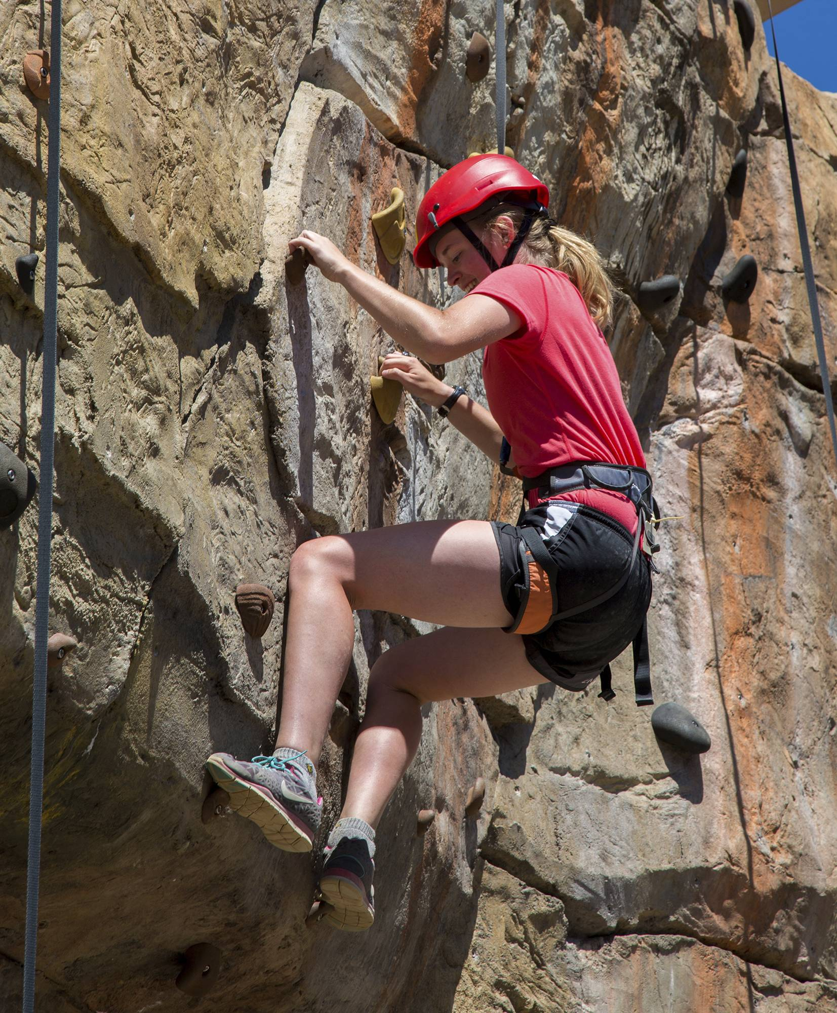 A Venture Scout scales one of the rock walls during her crew's adventure at the Summit Bechtel Reserve near Glen Jean, West Virginia.
