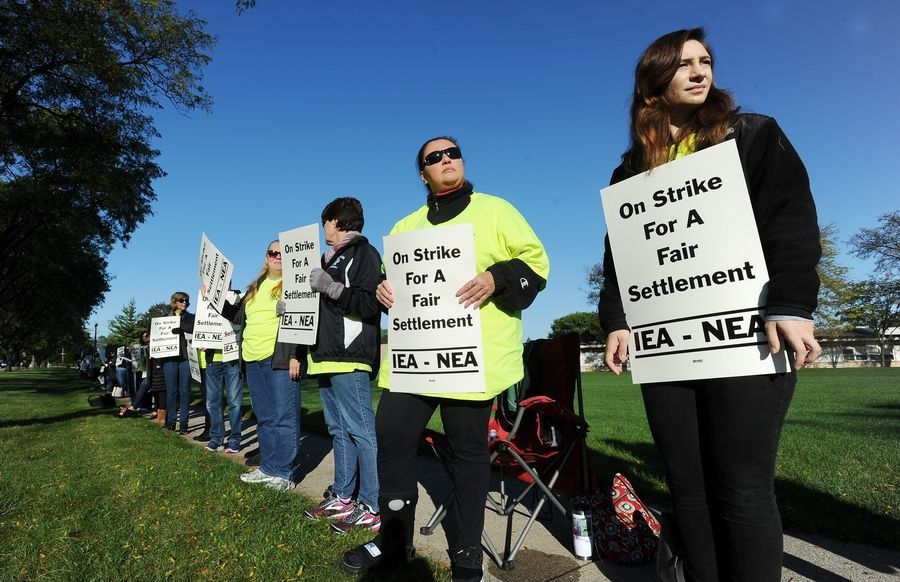 Palatine Township Elementary District 15 board members Wednesday night voted in favor of a five-year contract with support employees who went on strike for 10 days in October. These strikers were outside Winston Campus in Palatine.
