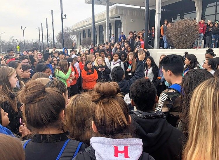 Hoffman Estates High School students rally outside the building Wednesday as they took part in a national student walkout to urge lawmakers to pass stricter gun control measures.