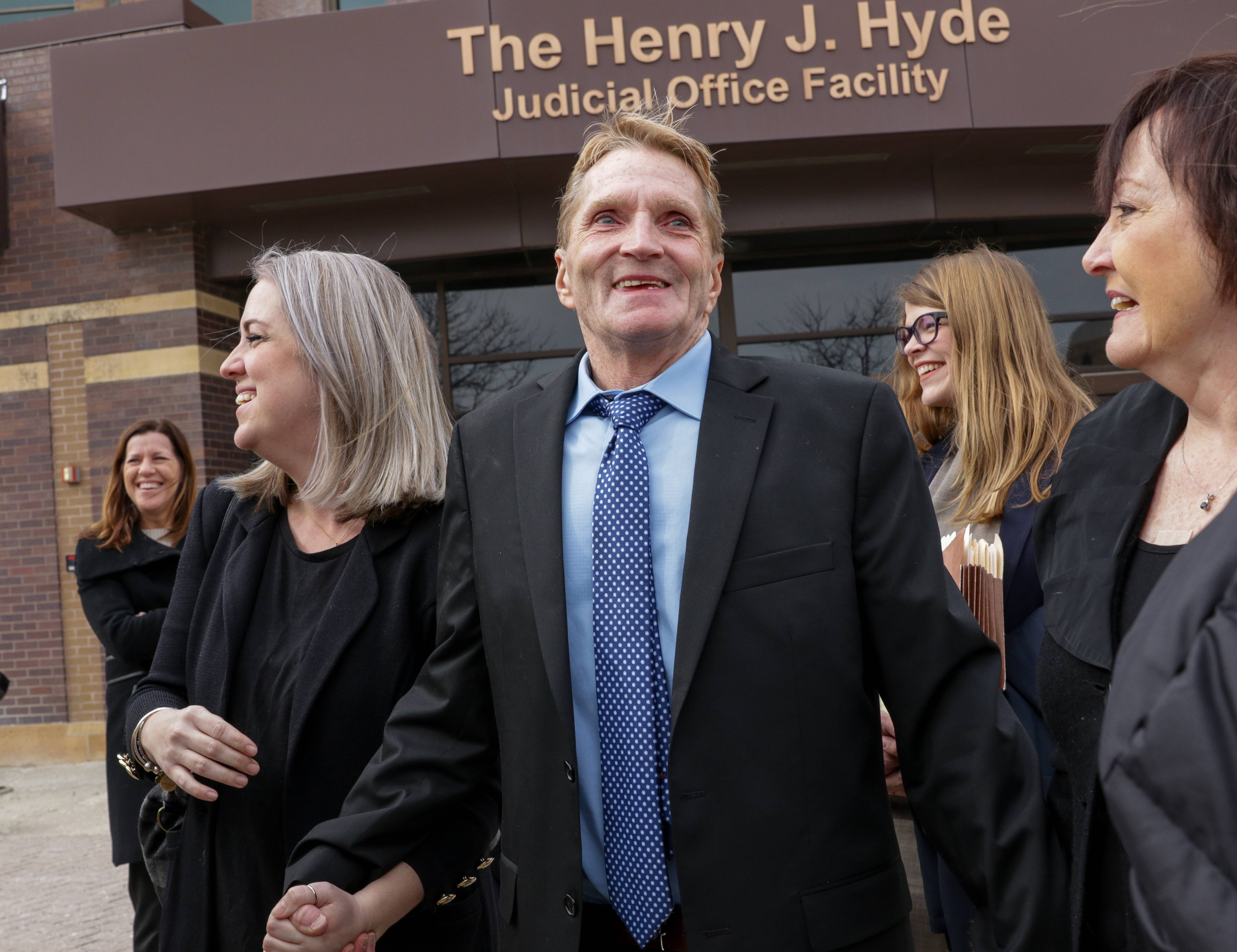 William Amor is all smiles as he leaves the DuPage County Courthouse Wednesday with attorney Lauren Kaeseberg, left, and his sister Shelley Williams, right. After spending 22 years in prison, Amor was found not guilty in the 1995 death of his mother-in-law.