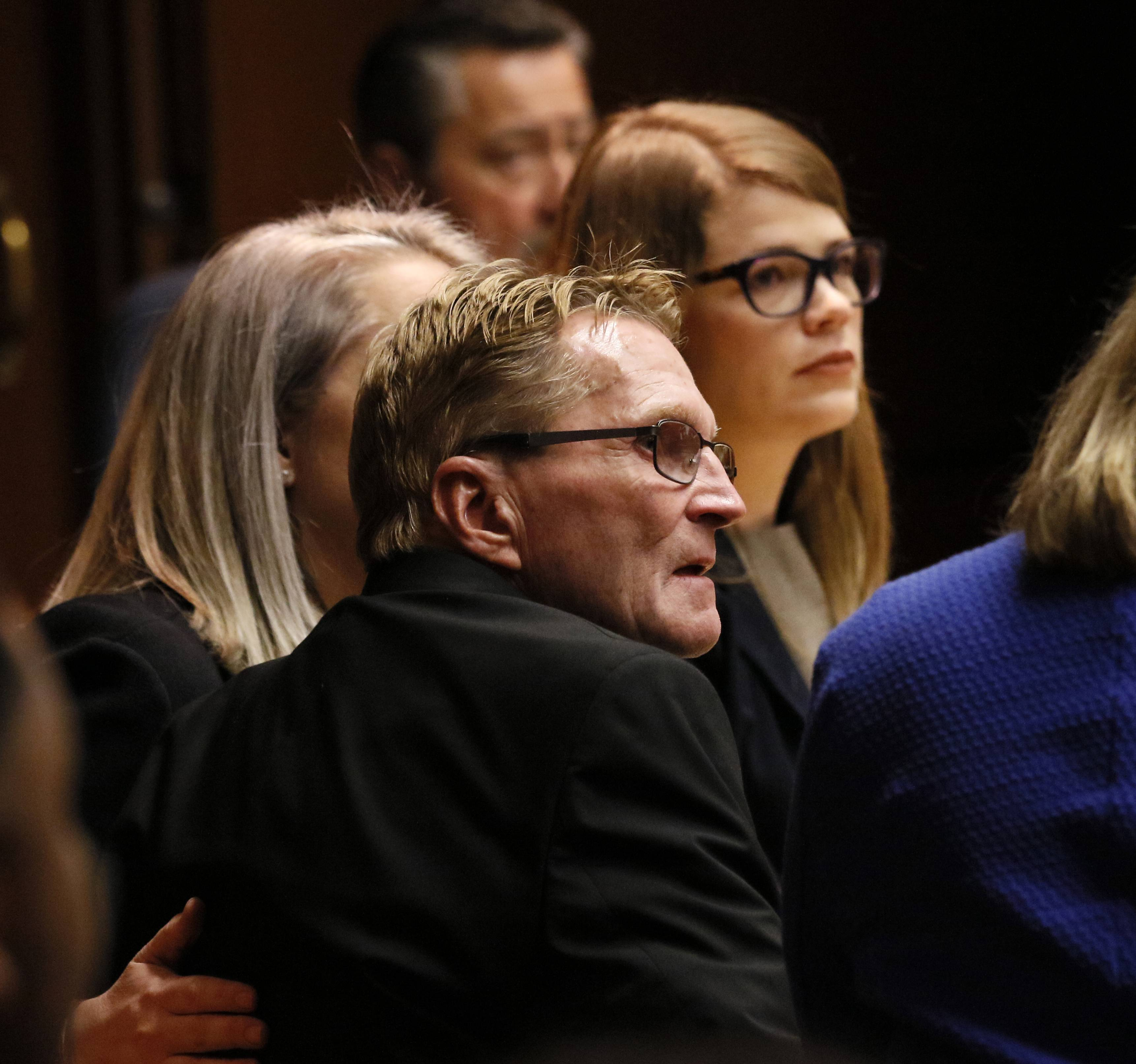 William Amor and his attorneys, Lauren Kaeseberg and Lauren Myerscough-Mueller, look to the prosecution while DuPage County Judge Liam Brennan reads his not-guilty verdict at the DuPage County Courthouse.