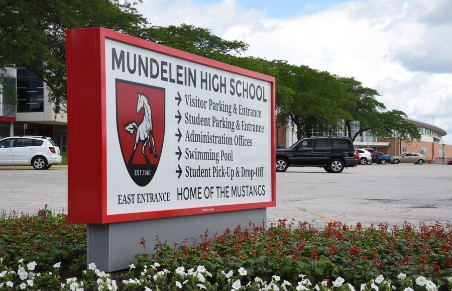 A Mundelein High School student has been disciplined for wearing earrings that spelled a racial slur.