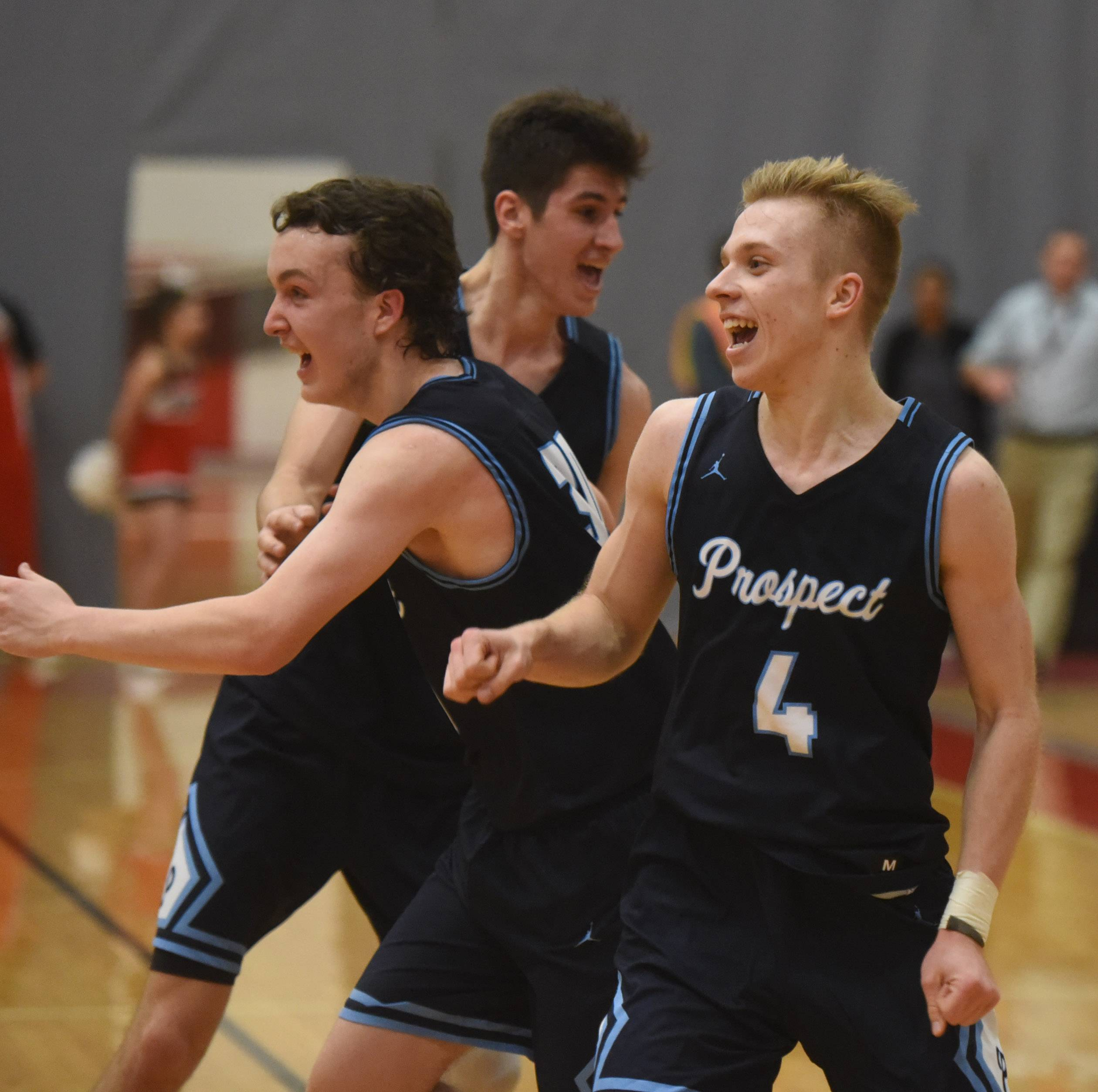 Prospect's David Swedera, front, celebrates with his teammates following their victory over Barrington during the Mid-Suburban League boys basketball championship game at Barrington Wednesday.