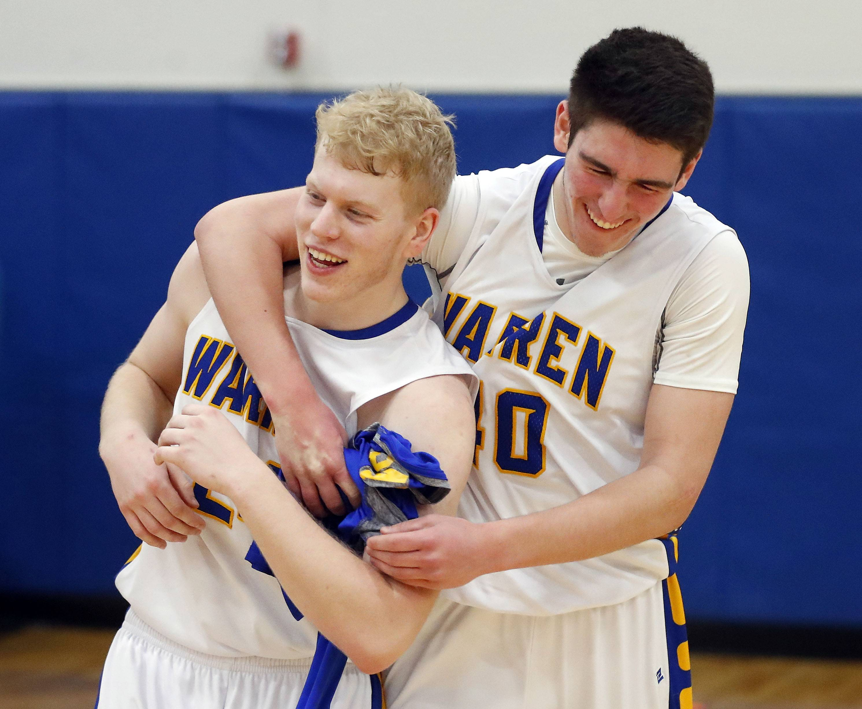 Warren's Ryan Short, left, and Warren's Adnan Sarancic celebrate after a win over Stevenson Wedensday night in Gurnee.