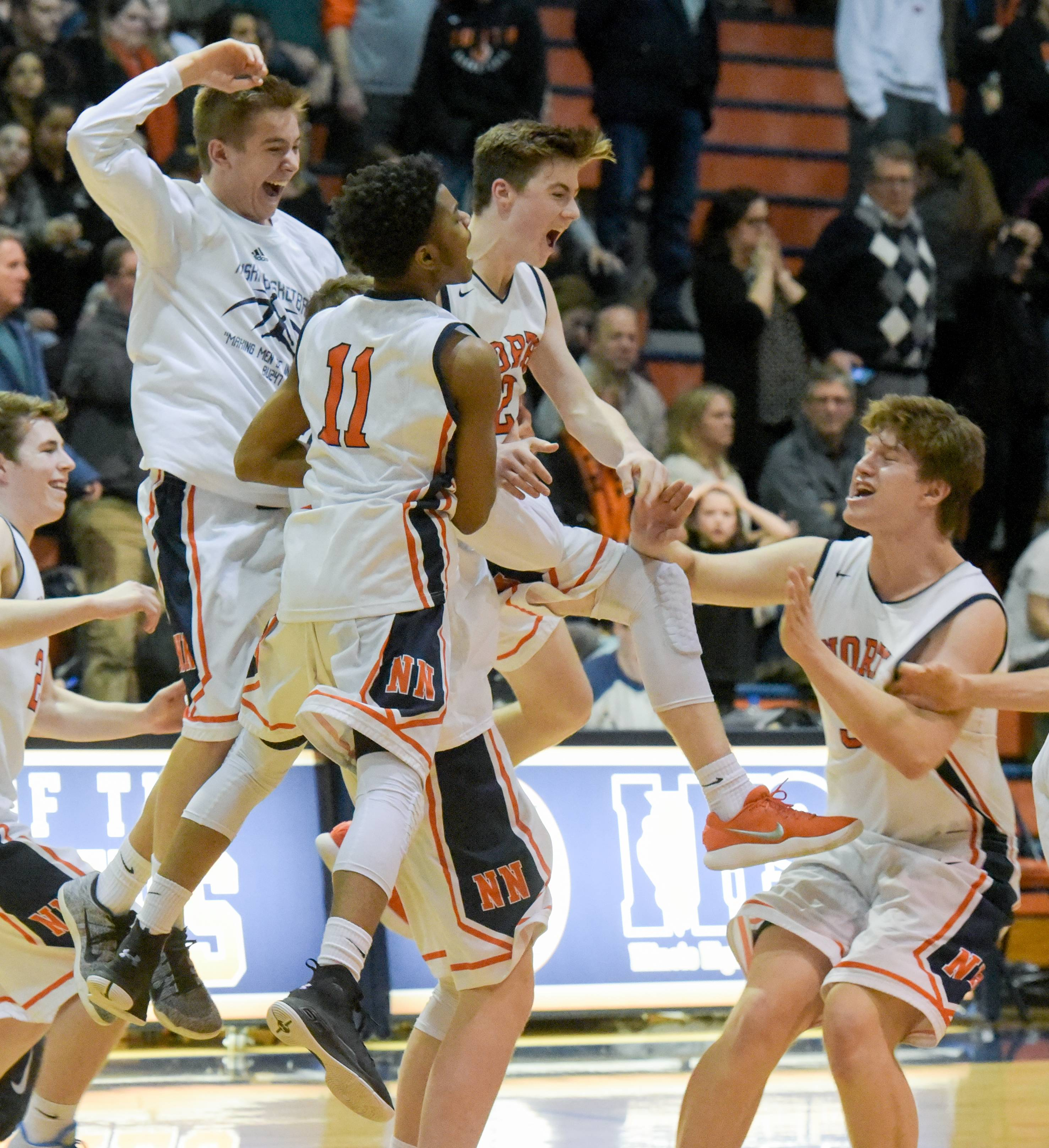Naperville North celebrates their 37-35 win in double overtime over Wheaton Warrenville South on February 21, 2018.