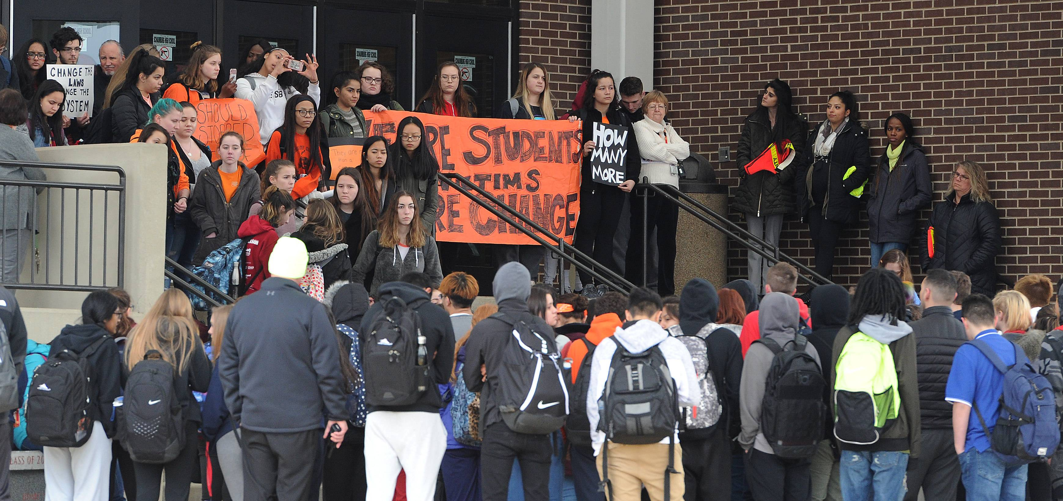 Hundreds of Schaumburg High School students walked out of school Wednesday to push for stricter gun control measures. Similar walkouts took place in other suburbs and across the country to make the one-week anniversary of the killing of 17 students and staff at a Florida high school.