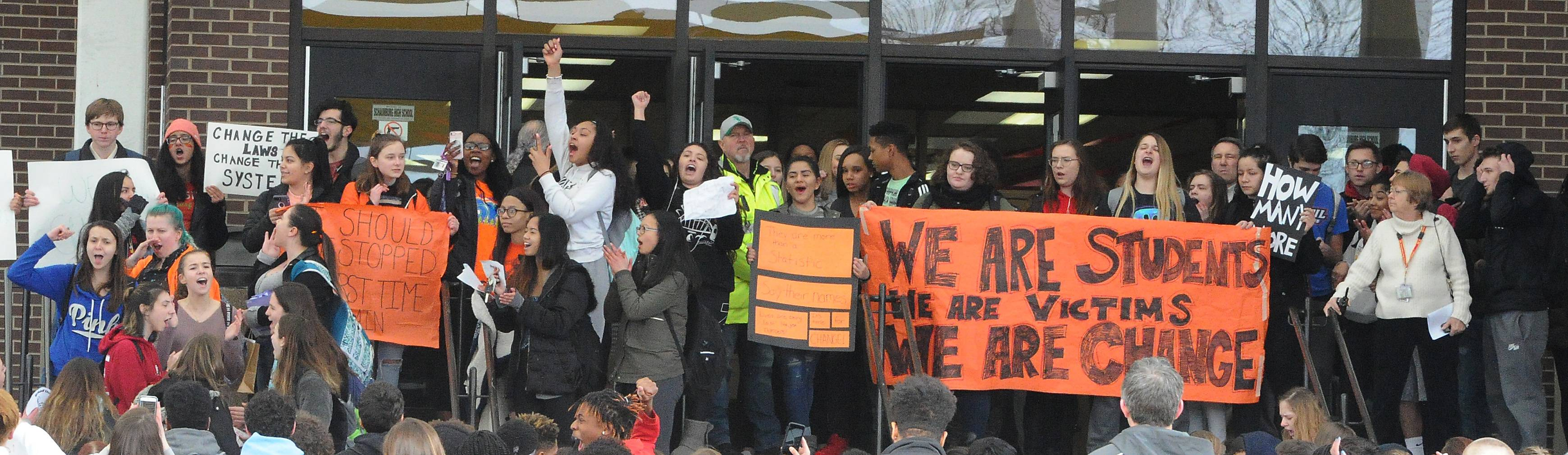 Schaumburg High School students rally in front of the school Wednesday to advocate for more gun control in the wake of 17 students and staff members being killed last week at a Florida high school.