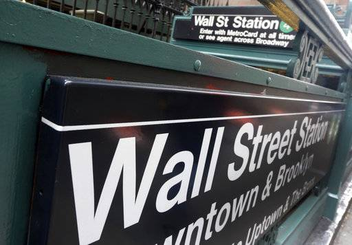 FILE- In this Oct. 2, 2014, file photo, the Wall Street subway stop on Broadway, in New York's Financial District. The U.S. stock market opens at 9:30 a.m. EST on Wednesday, Feb. 21, 2018.