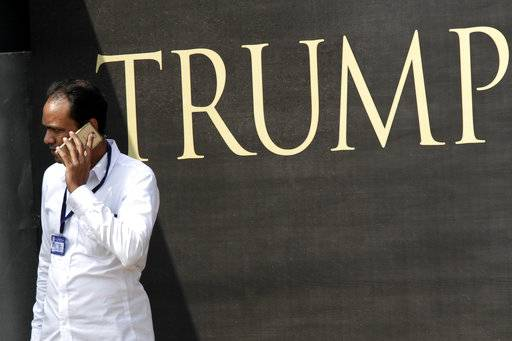 "A security guard talks on mobile phone outside the construction site of the Trump Tower in Kolkata, India, Wednesday, Feb. 21, 2018. The eldest son of U.S. President Donald Trump, Donald Trump Jr. said any talk that his family was profiting from his father's presidency was ""nonsense"" as he began a visit to India to promote real estate deals that bear his family's name."