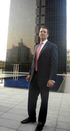 "The eldest son of U.S. President Donald Trump, Donald Trump Jr. poses for photographers in front of the Trump Towers after its inauguration in Pune, India, Wednesday, Feb. 21, 2018. Donald Trump Jr. said any talk that his family was profiting from his father's presidency was ""nonsense"" as he began a visit to India to promote real estate deals that bear his family's name."