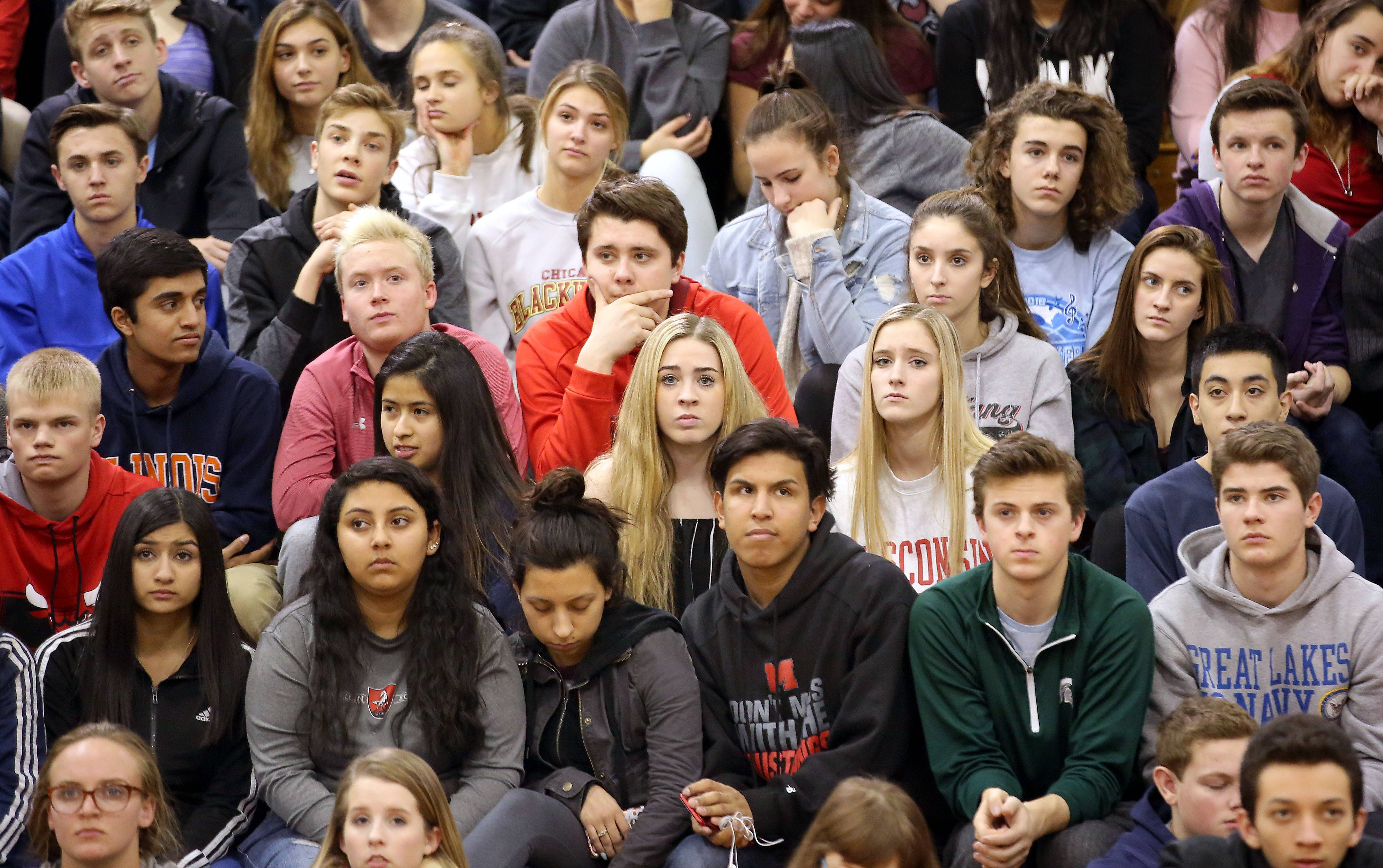 Mundelein High School students listen to Principal Anthony Kroll during an assembly Thursday about dealing with hate speech at the school.