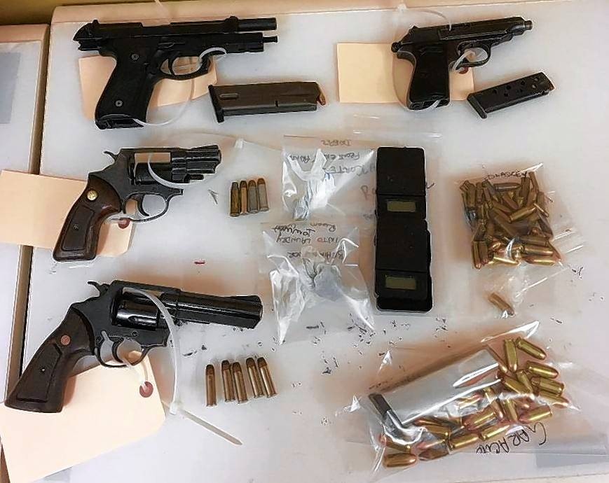 Police say they seized these guns and ammo during a search of an Aurora house on Feb. 16.