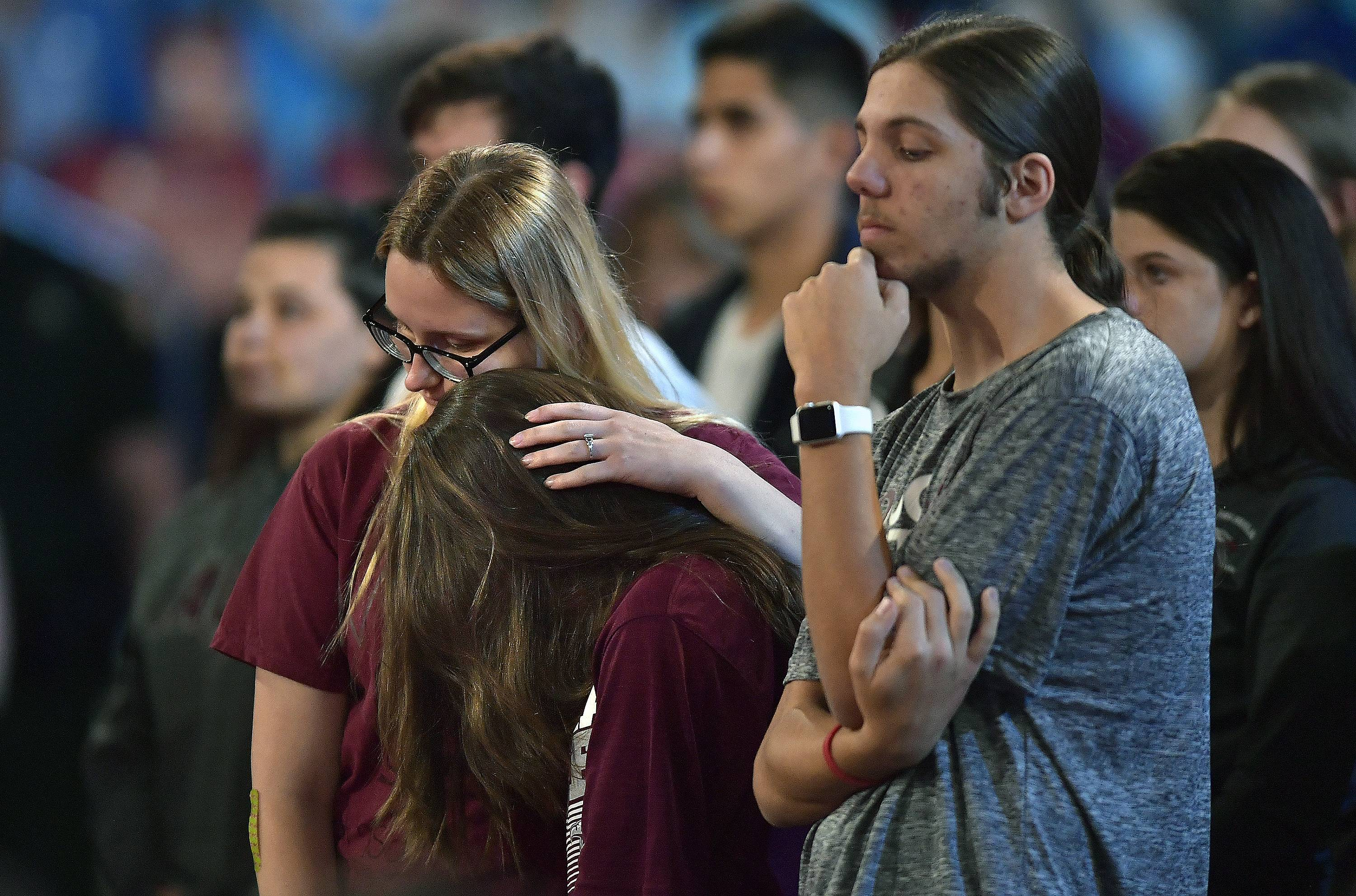 Marjory Stoneman Douglas High School students listen to Sheriff Scott Israel speak Wednesday before a CNN town hall broadcast at the BB & T Center in Sunrise, Florida.