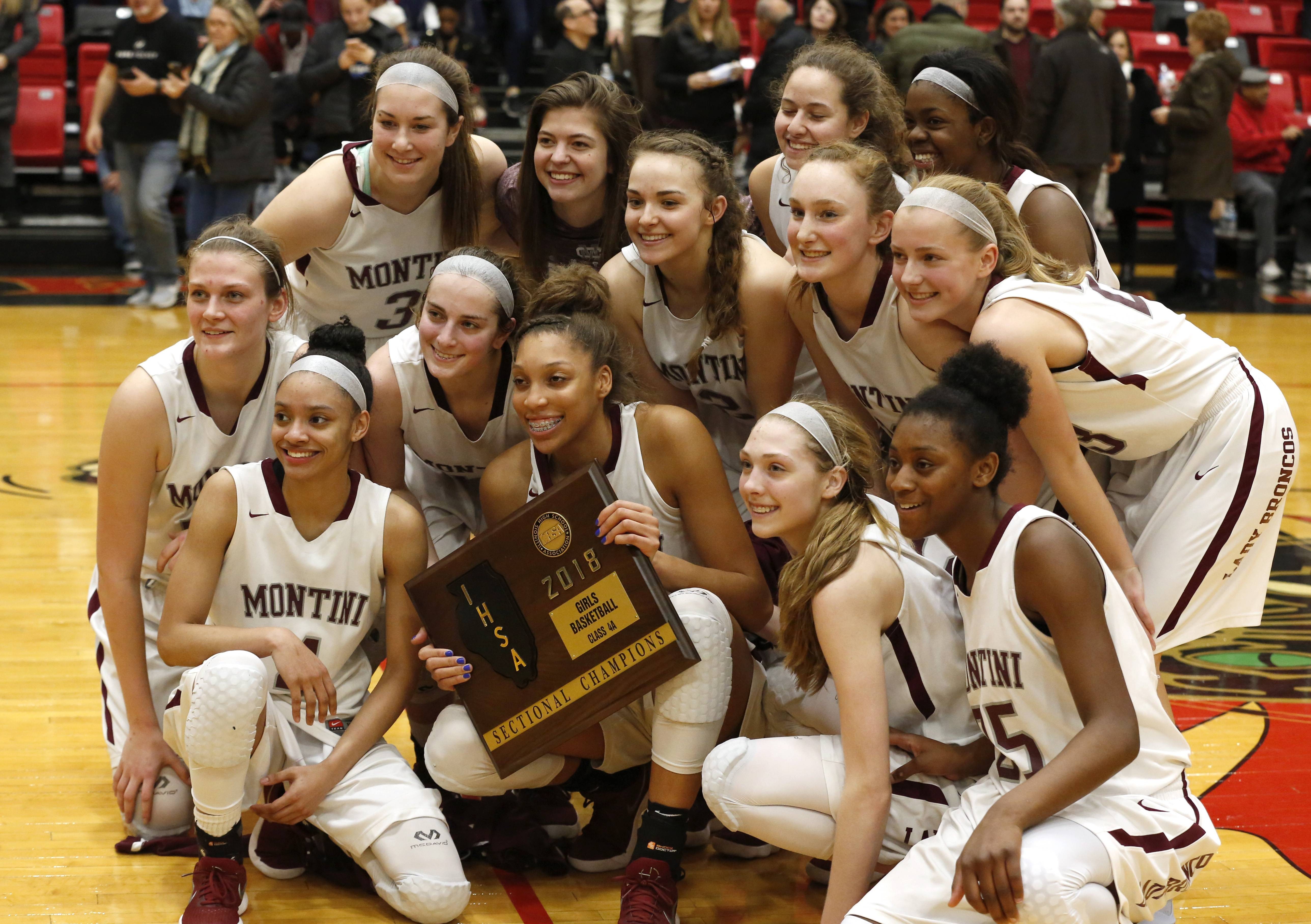 Montini Catholic players celebrate a 54-31 win over Benet Academy to win the Class 4A Proviso West girls basketball sectional championship.
