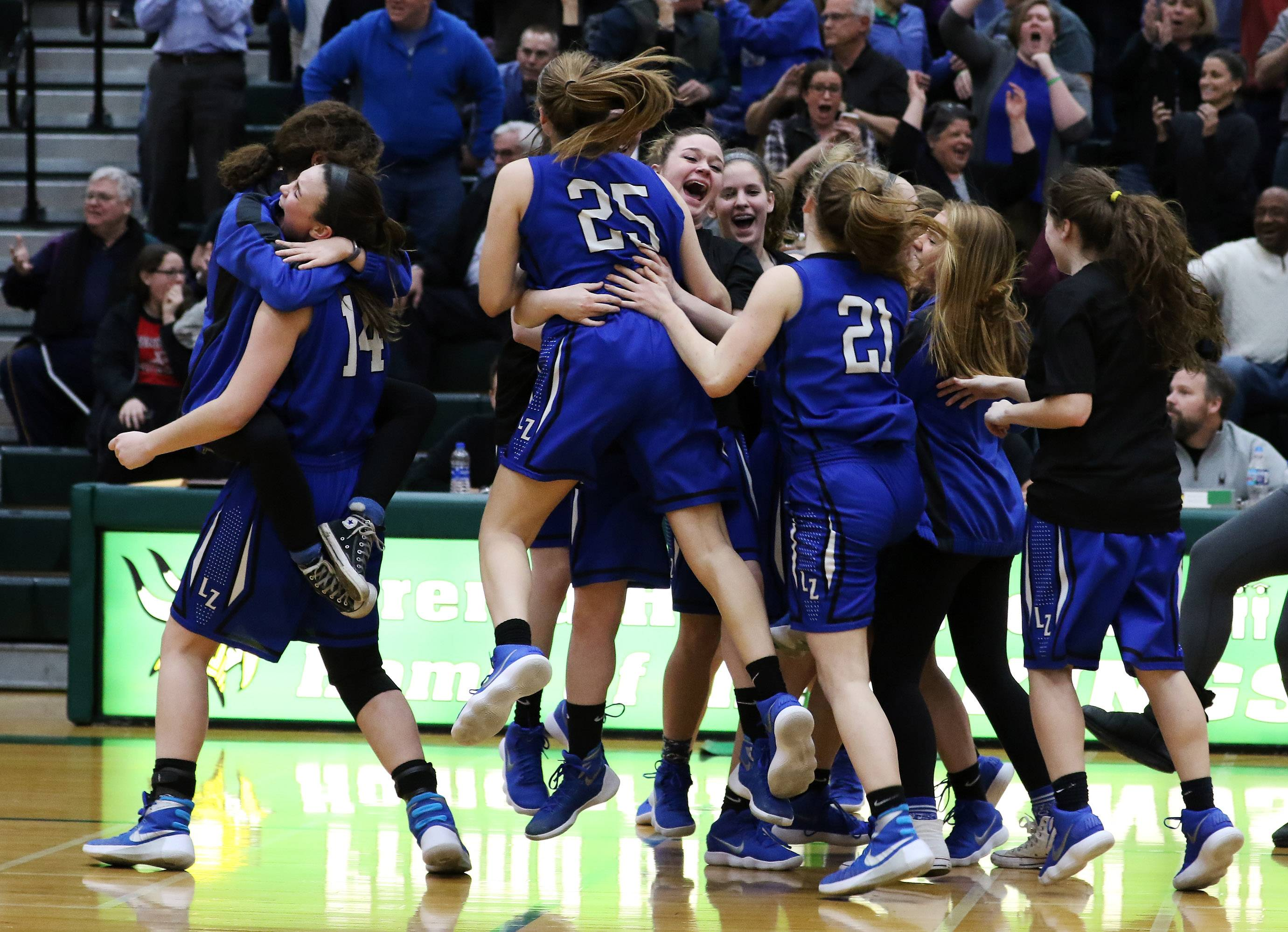 The Lake Zurich Bears celebrate after defeating Warren during the Class 4A girls basketball sectional final on Thursday at Fremd High School in Palatine.