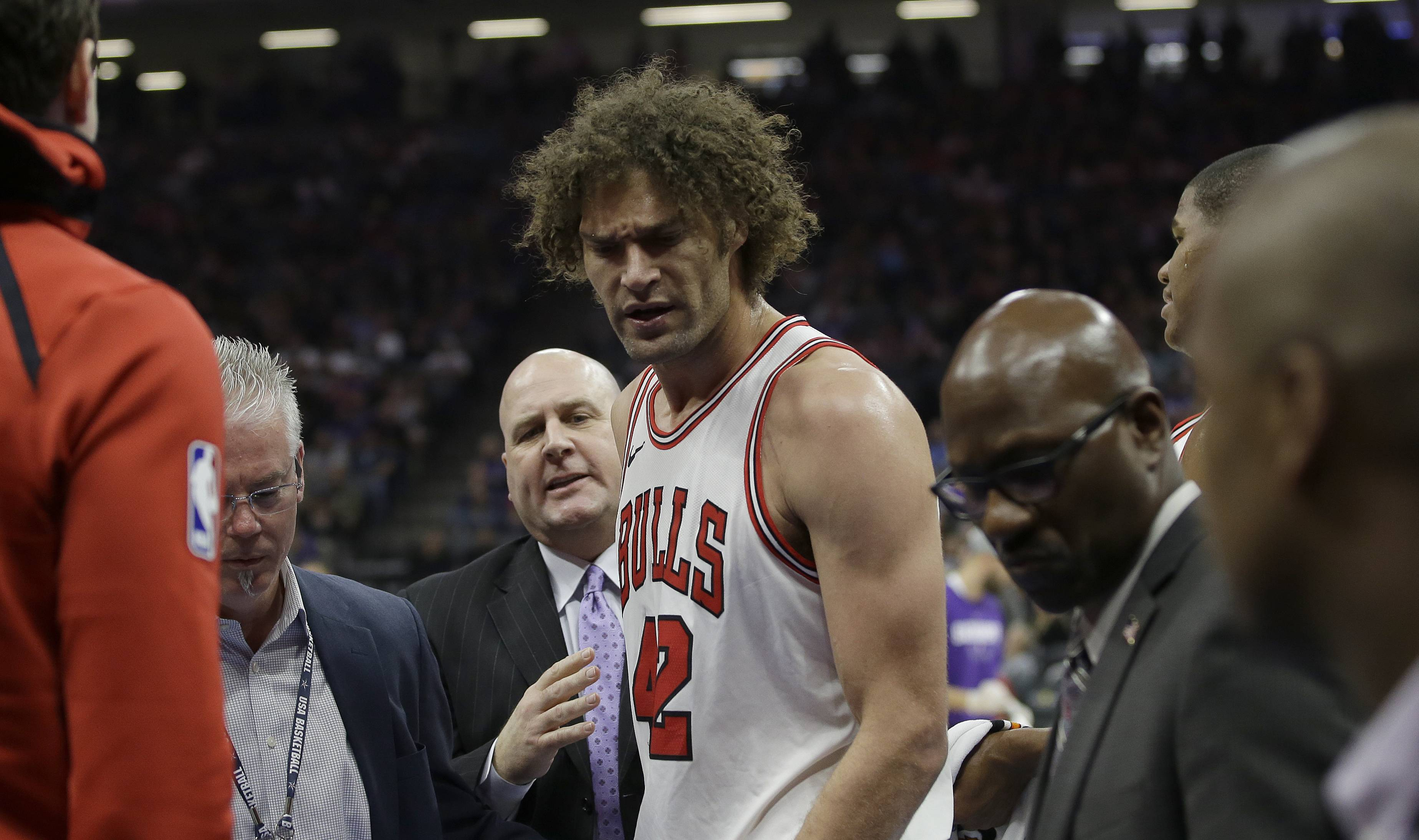 Chicago Bulls center Robin Lopez leaves the court after being ejected from the game when he received two technical foul during the second quarter of an NBA basketball game against the Sacramento Kings Monday, Feb. 5, 2018, in Sacramento, Calif. (AP Photo/Rich Pedroncelli)