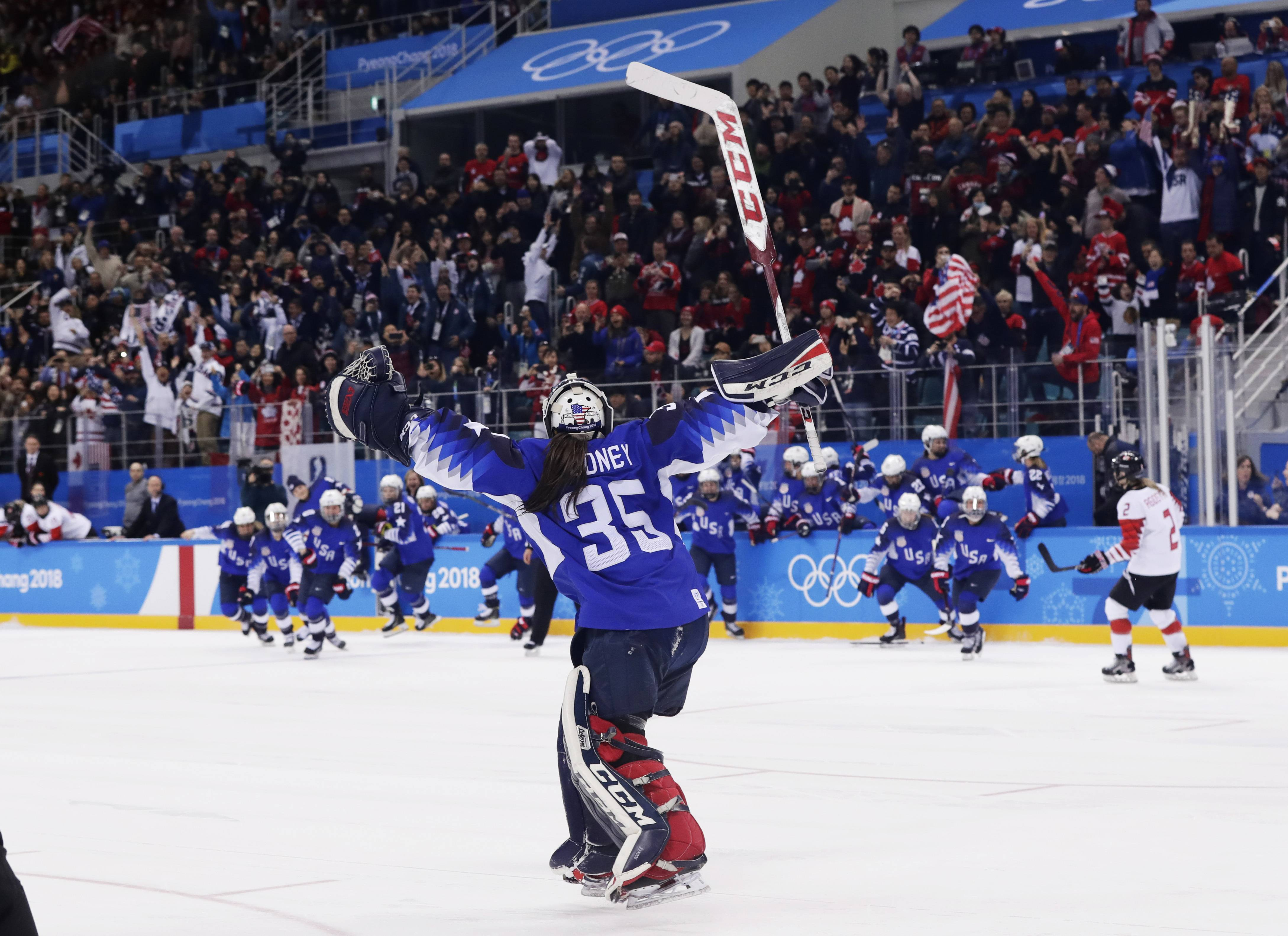 The United States players celebrate winning after the women's gold medal hockey game against Canada at the 2018 Winter Olympics in Gangneung, South Korea, Thursday, Feb. 22, 2018. (AP Photo/Frank Franklin II)