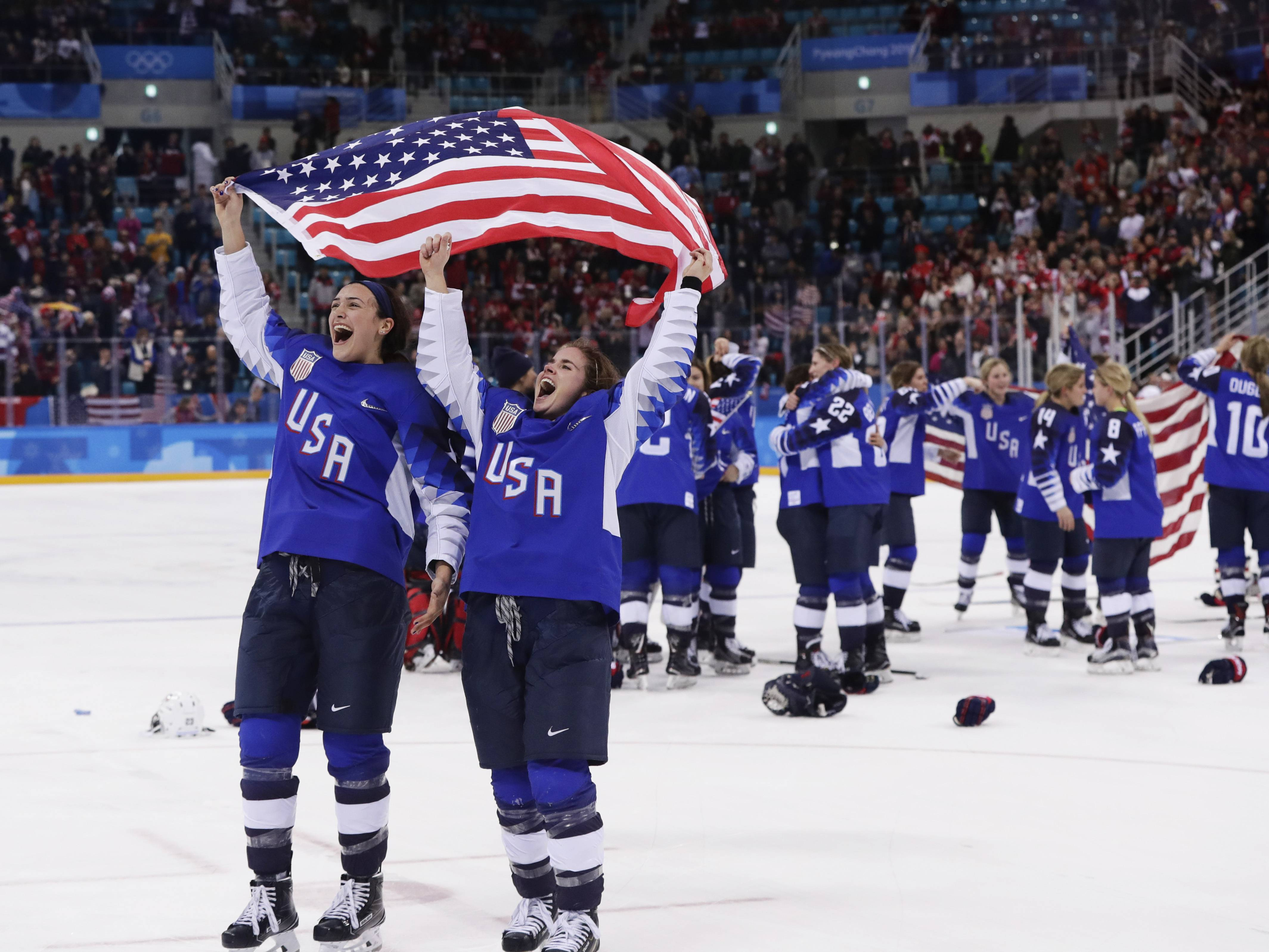 The United States players celebrate after winning the women's gold medal hockey game against Canada at the 2018 Winter Olympics in Gangneung, South Korea, Thursday morning.