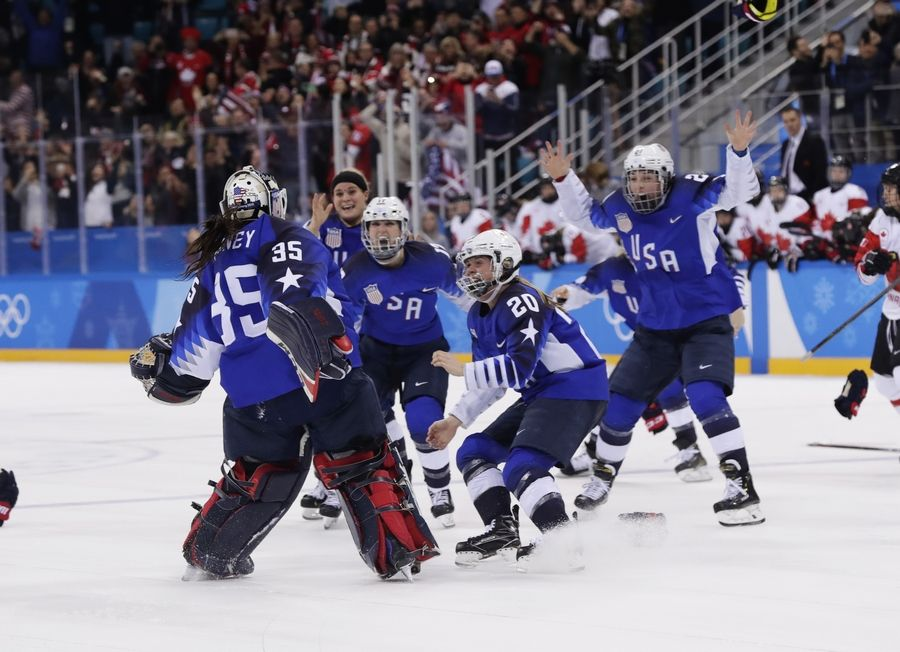 The United States team celebrates winning the women's gold medal hockey game against Canada at the 2018 Winter Olympics in Gangneung, South Korea, Thursday morning.