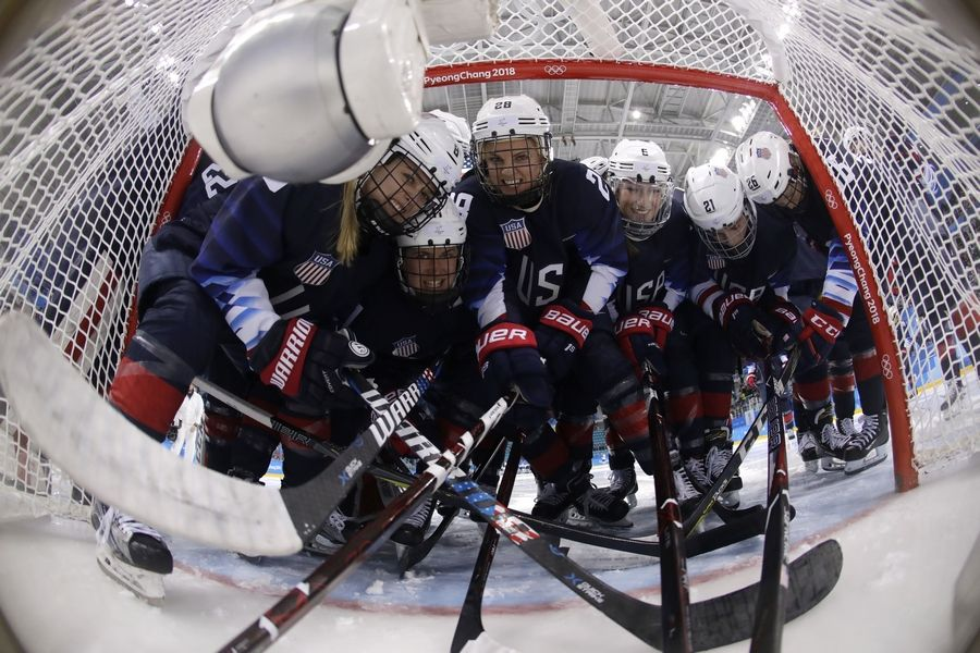 Players from the United States pose for the camera before the semifinal round of the women's hockey game against Finland at the 2018 Winter Olympics in Gangneung, South Korea, Monday.
