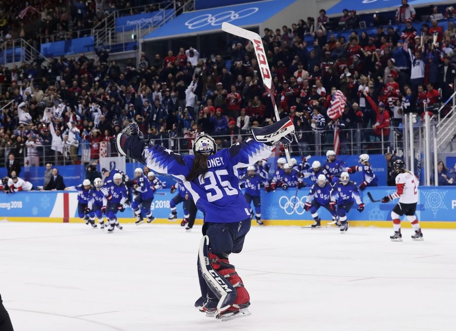 The United States players celebrate winning after the women's gold medal hockey game against Canada at the 2018 Winter Olympics in Gangneung, South Korea, Thursday.