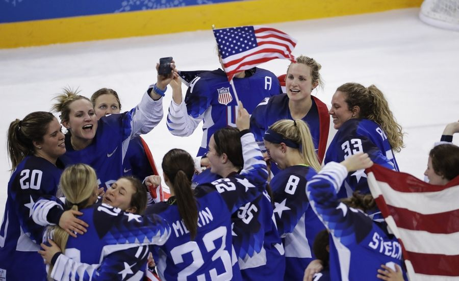 United States celebrates winning gold after the women's gold medal hockey game against Canada at the 2018 Winter Olympics in Gangneung, South Korea, Thursday, Feb. 22, 2018.