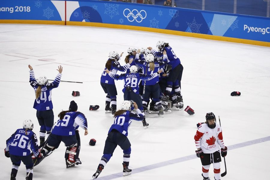 United States celebrates winning the women's gold medal hockey game against Canada at the 2018 Winter Olympics in Gangneung, South Korea, Thursday morning.