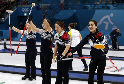 "In this Feb. 21, 2018 photo, South Korea's women's curling team celebrate after beating Russian athletes during their match at the 2018 Winter Olympics in Gangneung, South Korea. The team known as the ""Garlic Girls"" came into the Pyeongchang Games as the underdog who few believed would medal. Now they're No. 1 in the rankings. (AP Photo/Aaron Favila)"