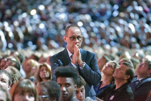 "Parent Fred Guttenberg watches a monitor honoring the 17 students and teachers who were killed at Marjory Douglas Stoneman High School, during a CNN ""Stand Up"" town hall meeting, Wednesday, Feb. 21, 2018, in Sunrise, Fla. Guttenberg's 14-year-old daughter Jaime Guttenberg was killed on Feb. 14 with 16 others. (Michael Laughlin/South Florida Sun-Sentinel via AP)"