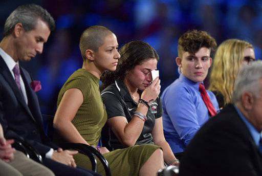 Marjory Stoneman Douglas High School student Emma Gonzalez comforts a classmate during a CNN town hall meeting, Wednesday, Feb. 21, 2018, at the BB&T Center, in Sunrise, Fla. (Michael Laughlin/South Florida Sun-Sentinel via AP)