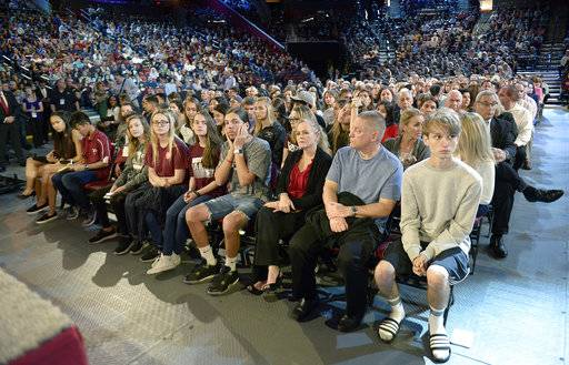 Marjory Stoneman Douglas High School students and parents wait for a CNN town hall broadcast to begin, Wednesday, Feb. 21, 2018, at the BB&T Center, in Sunrise, Fla. (Michael Laughlin/South Florida Sun-Sentinel via AP)