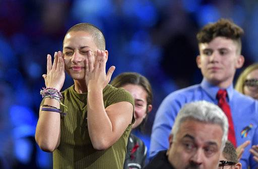 Marjory Stoneman Douglas High School student Emma Gonzalez wipes away tears during a CNN town hall meeting, Wednesday, Feb. 21, 2018, at the BB&T Center, in Sunrise, Fla. (Michael Laughlin/South Florida Sun-Sentinel via AP)