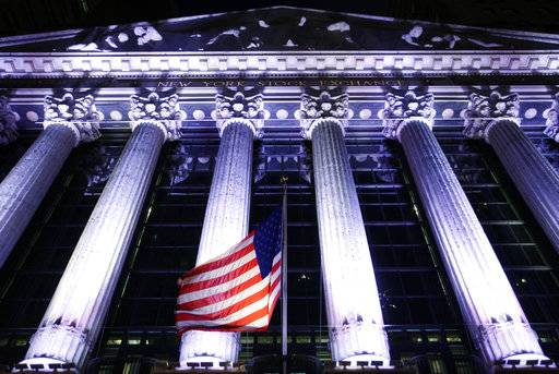 FILE - In this Oct. 8, 2014, file photo, an American flag flies in front of the New York Stock Exchange in New York. The U.S. stock market opens at 9:30 a.m. EST on Thursday, Feb. 22, 2018. (AP Photo/Mark Lennihan, File)