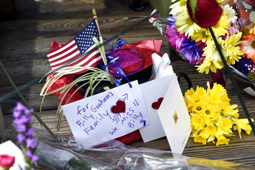 Flowers and notes are left outside Chatlos Chapel in tribute to Rev. Billy Graham at the Billy Graham Training Center, Thursday, Feb. 22, 2018 in Asheville, NC. Graham's body will lie in honor in the U.S. Capitol Rotunda next week, the first time a private citizen has been accorded such recognition since civil rights hero Rosa Parks in 2005. The two-day viewing in Washington on Feb. 28 and March 1 will be part of nine days of mourning for postwar America's most famous evangelist, who died Wednesday at his home in North Carolina's mountains at age 99. (AP Photo/Kathy Kmonicek)