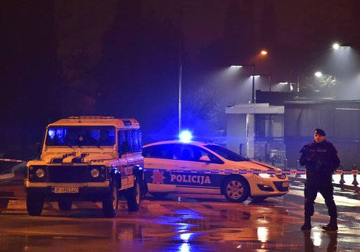 Police block off the area around the U.S. Embassy in Montenegro's capital Podgorica, Thursday, Feb. 22, 2018. Local media say that an unknown assailant hurled a hand grenade toward the embassy at around midnight local time (1100 GMT) and then killed himself with another explosive device.