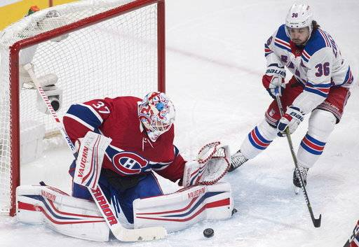Montreal Canadiens goaltender Antti Niemi makes a save against New York Rangers' Mats Zuccarello during the second period of an NHL hockey game Thursday, Feb. 22, 2018, in Montreal. (Graham Hughes/The Canadian Press via AP)