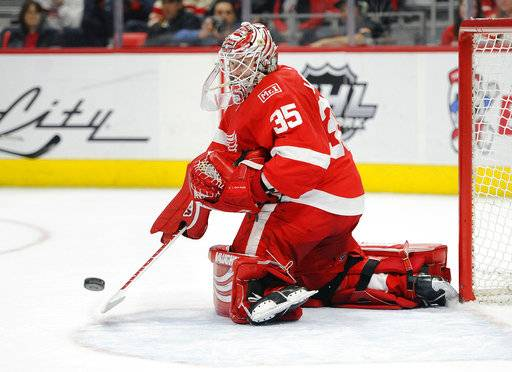 Detroit Red Wings goaltender Jimmy Howard makes a save against the Buffalo Sabres during the first period of an NHL hockey game Thursday, Feb. 22, 2018, in Detroit.
