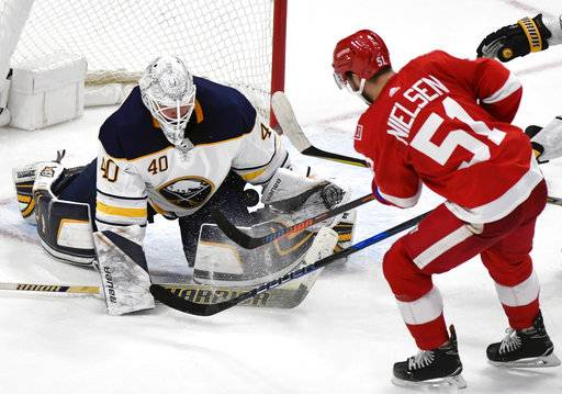Buffalo Sabres goaltender Robin Lehner (40), of Sweden, makes a save on Detroit Red Wings center Frans Nielsen (51), of Denmark, during the third period of an NHL hockey game, Thursday, Feb. 22, 2018, in Detroit. The Sabres defeated the Red Wings 3-2 in overtime.