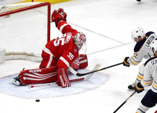 Detroit Red Wings goaltender Jimmy Howard (35) makes a save on Buffalo Sabres center Johan Larsson (22) in overtime of an NHL hockey game Thursday, Feb. 22, 2018, in Detroit. The Sabres won 3-2.