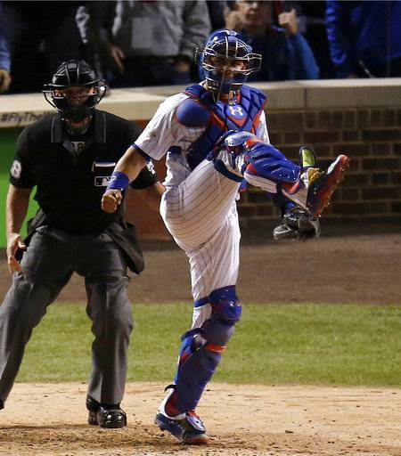 FILE - In this Oct. 18, 2017, file photo, Chicago Cubs catcher Willson Contreras reacts after Los Angeles Dodgers' Chase Utley (not shown) struck out during the eighth inning of Game 4 of baseball's National League Championship Series, in Chicago. In his first full season in the majors, Contreras established himself as one of baseball's top catchers and earned respect as a leader behind the plate for the Cubs. He comes into this season with a chance to solidify himself as one of the top players on one of the top teams. (AP Photo/Charles Rex Arbogast, File)