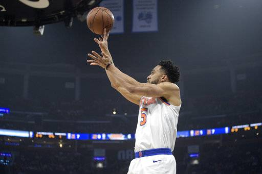 New York Knicks guard Courtney Lee (5) goes up for a shot during the first half of an NBA basketball game against the Orlando Magic Thursday, Feb. 22, 2018, in Orlando, Fla. (AP Photo/Phelan M. Ebenhack)
