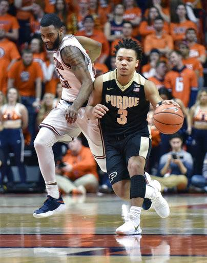 Purdue guard Carsen Edwards (3) makes a move down the court past Illinois guard Mark Alstork (24) during the first half of an NCAA college basketball game in Champaign, Ill., Thursday, Feb. 22, 2018. (AP Photo/Stephen Haas)