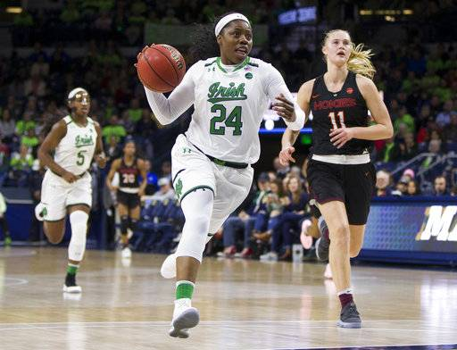 Notre Dame's Arike Ogunbowale (24) drives downcourt in front of Virginia Tech's Regan Magarity (11) during the first half of an NCAA college basketball game Thursday, Feb. 22, 2018, in South Bend, Ind. (AP Photo/Robert Franklin)