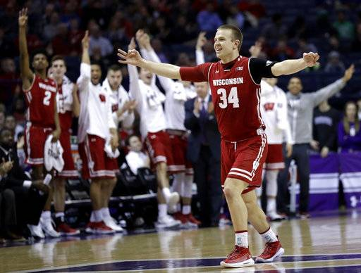 Wisconsin guard Brad Davison(34) celebrates after forward Andy Van Vliet made a three-point basket Northwestern during the first half of an NCAA college basketball game Thursday, Feb. 22, 2018, in Rosemont, Ill. (AP Photo/Nam Y. Huh)