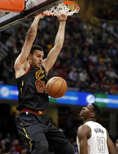 Cleveland Cavaliers' Larry Nance Jr. (24) dunks against Washington Wizards' Ian Mahinmi (28) in the first half of an NBA basketball game, Thursday, Feb. 22, 2018, in Cleveland. (AP Photo/Tony Dejak)