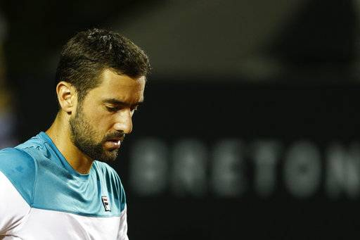 Croatia's Marin Cilic reacts after failing to return the ball to France's Gael Monfils during the Rio Open tennis tournament in Rio de Janeiro, Brazil, Thursday, Feb. 22, 2018. (AP Photo/Leo Correa)