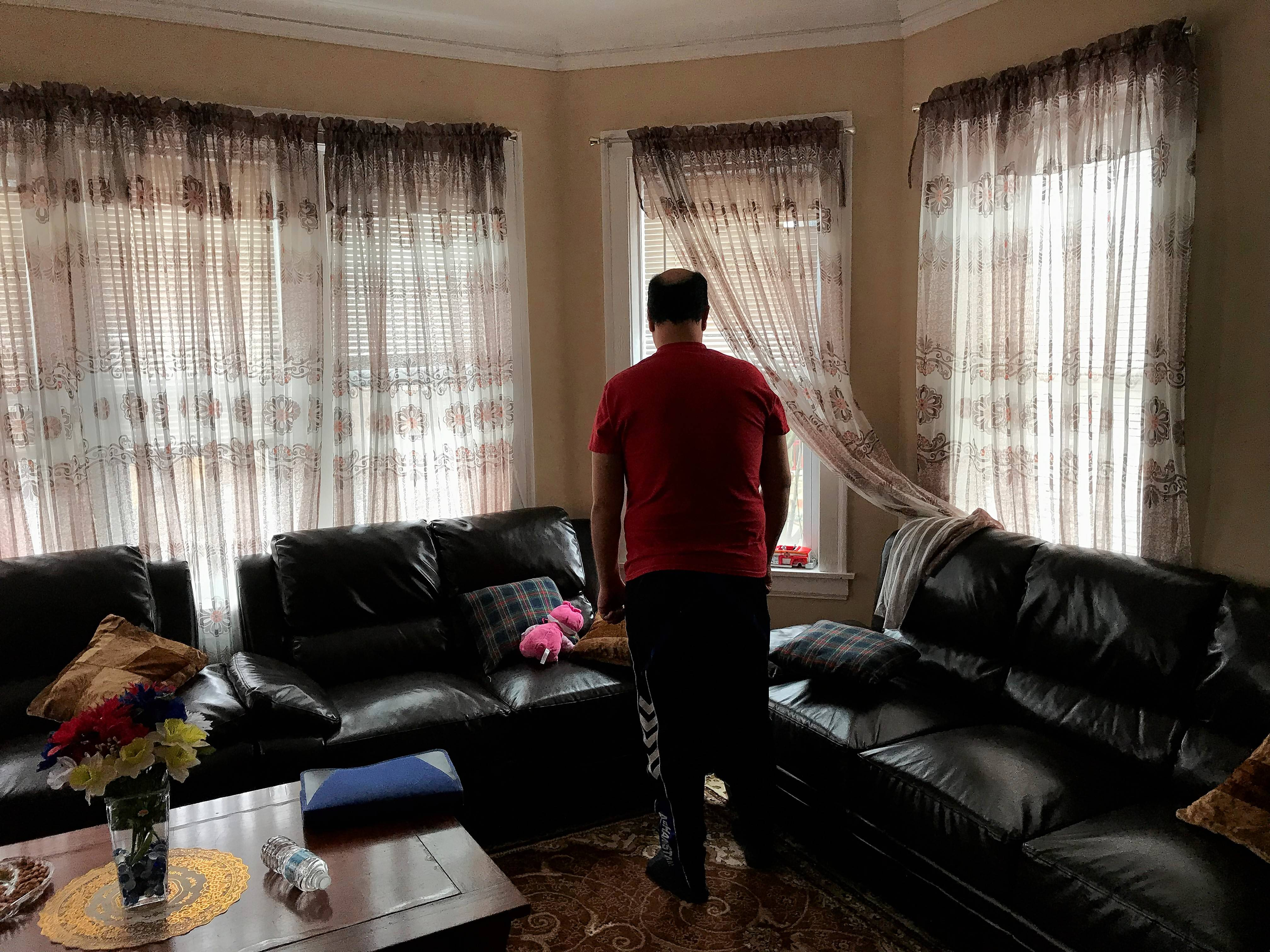 """M. Jan,"" a father from Afghanistan pictured in his Chicago living room, said he will never forget the help his family got in resettling from First Congregational United Church of Christ in Elgin."