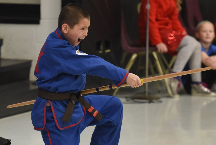 North Barrington Elementary School third grade student Aaron Castic gives a martial arts demonstration Friday during a talent show at the school.